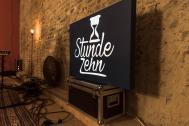 Stunde Zehn Logo